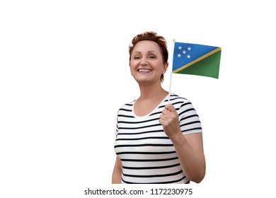 Solomon Islands flag. Woman holding Solomon Islands flag. Nice portrait of middle aged lady 40 50 years old with a national flag isolated on white background.