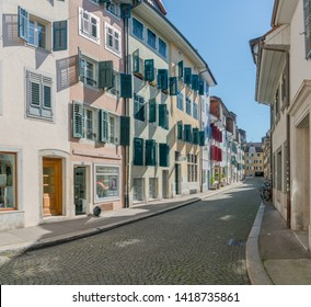 Solothurn, SO / Switzerland - 2 June 2019: historic old town cobblestone street in the Swiss city of Solothurn with ist medieval bourgoisie houses on cobblestone street