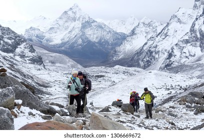 SOLU KHUMBU, NEPAL, May 11, 2017: The Hikers continue hiking to Cholla La Pass located in the middle of the Himalaya Mountains, Nepal.