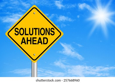 Solution ahead text is on road sign with blue sky background.
