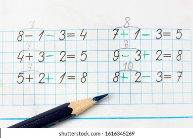 Solution is basic examples of mathematics in elementary school on a sheet of a notebook with a pencil.