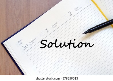Solution text concept write on notebook with pen