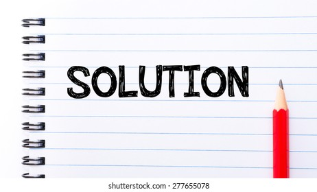 Solution Text written on notebook page, red pencil on the right. Motivational Concept image