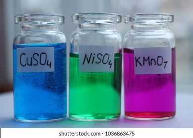 Solutions of copper sulfate, cobalt sulfate and potassium permanganate.