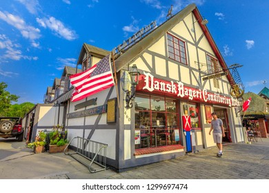 Solvang, California, United States - August 10, 2018: traditional Danish bakery, Dansk Bageri, typical Danish village of Solvang in California. Santa Ynez Valley. Blue sunny sky with american flag.