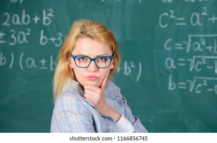 Solve mathematics task. Teacher woman think about solving and result. Lady wear eyeglasses smart teacher classroom chalkboard background, close up. Solve that task. School education basic knowledge.