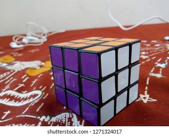 A solved 3x3 Rubic's Cube on a bedsheet