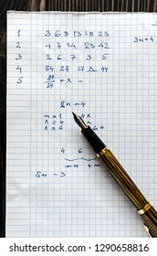 Solving a mathematical problem in a  piece of paper, from above