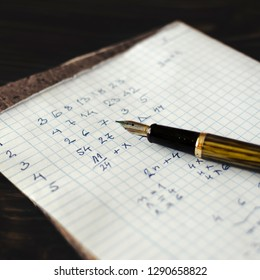 Solving a mathematical problem in a  piece of paper, close up