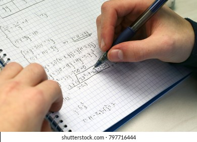 Solving a system equation in high school. Closeup view.