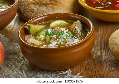 Solyanka, Russian traditional soups , assorted dishes, Top view.contain pickled cucumbers with brine, and often cabbage, salted mushrooms, potatoes, smetana