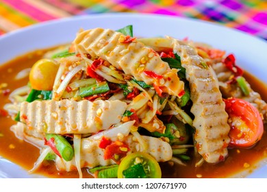 Som Tam Vietnamese Pork Sausage (Spicy Papaya Salad) with salted crab, on wooden table ( Thai food)