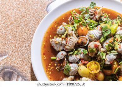 Som Tum, Papaya salad shellfish blood cockles and squid.