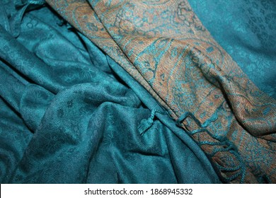 Sombor, Serbia, 12.06.2020. - Sandy border in the middle of an ocean....Blue pashmina shawl with yellow traditional motifs.