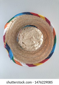 Sombrero in English refers to a type of wide-brimmed hat from Mexico, used to shield from the sun. It usually has a high pointed crown, an extra-wide brim