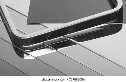 some abstract mirroring metallic object and surfaces