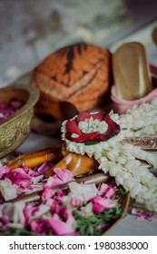 Some of the accessories for traditional Javanese weddings, including blangkon(Javanese hats) for the groom, keris(javanese weapon), selop(bridal shoes), flowers in copper vessels