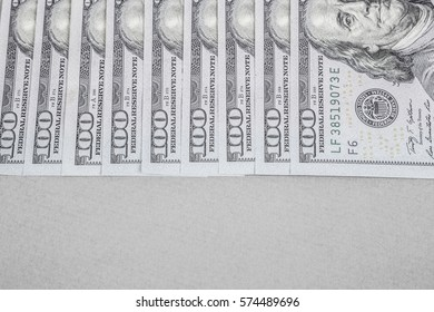 Some American Dollars as a border on grey background
