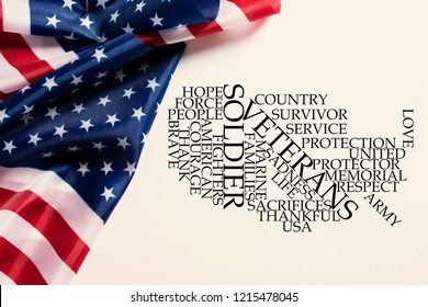 some american flags and a tag cloud, in the shape of the map of the United States, with words to honor the military veterans and their service to the nation