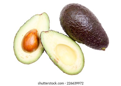 Some avocado seen from above on white background