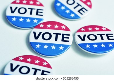 some badges with the word vote written in it, for the United States election, with a slight vignette added