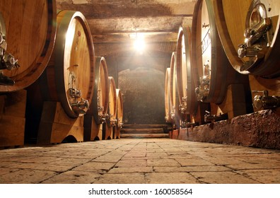 Some barrels in a  cellar