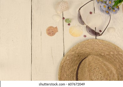 Some beach accessories with copy space on the white wooden table