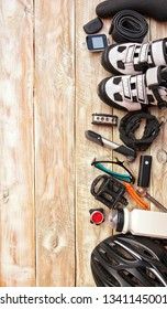 Some bicycle accessories on the wooden background