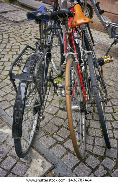 Some bicycles parked on a cobbled surface