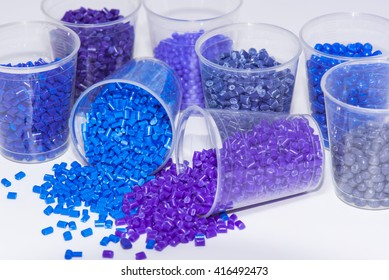 some blue and violet dyed thermoplastic resin on white background