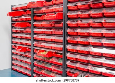 Some boxes with various screws and wall fixings in a hardware store
