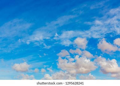 Some bright fluffy clouds at dark blue sky