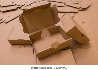 Some brown cardboard boxes, some closed, one opened
