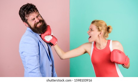 Some call them opponents. knockout punching. who is right. win the fight. Strength and power. family couple boxing gloves. problems in relationship. sport. bearded man hipster fighting with woman.