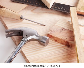 Some carpentry tools on a wooden table
