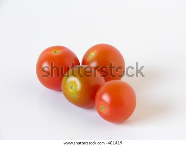 some cherry tomatoes over white background
