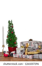 Some christmas presents and decorations on a table with white copy space background.
