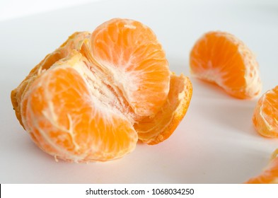 Some clementines on white background