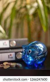 Some coins, coins and a blue piggy bank, Portrait