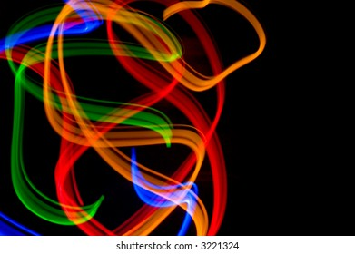 some colorful LED lights in motion resembling ribbons