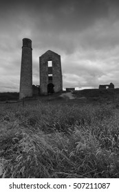 Some derelict buildings, including a chimney at a disused mine, Magpie Mine, in the Peak District