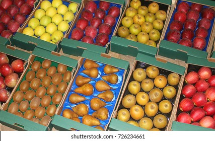 some different fruit in the boxes