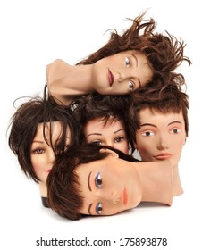 some different mannequin heads on a white background