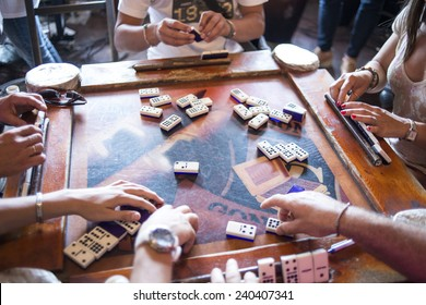 some domino players on the old table