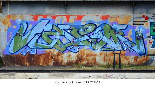 Some elements of a large and composite graffiti pattern on the wall, made with different colors of aerosol paints