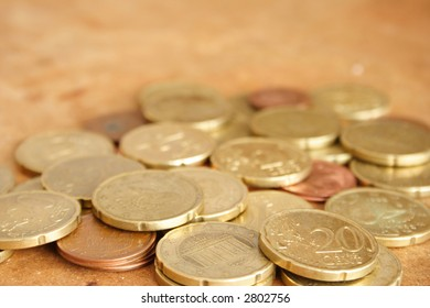Some europeans coins in a brown background