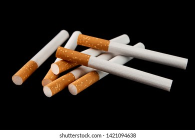 Some filter cigarettes isolated on black background