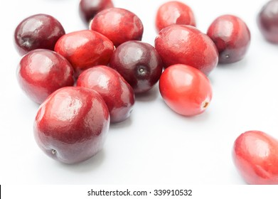 Some Fresh Cranberries on white background