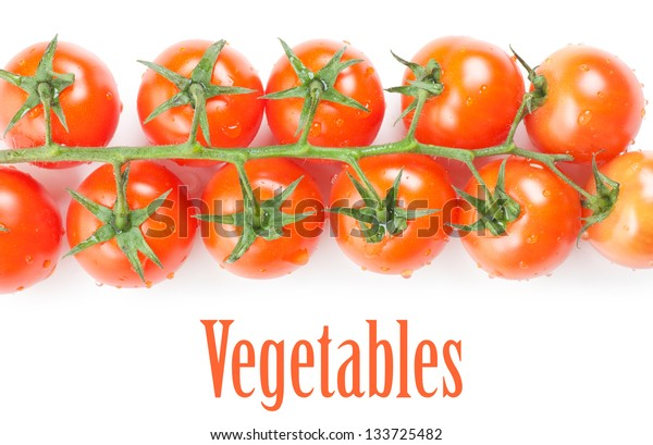 Some fresh ripe cherry tomatoes on a branch isolated over white background