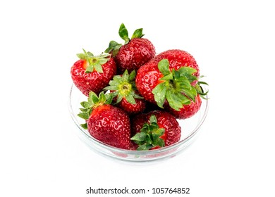 Some fresh strawberries in glass container.
